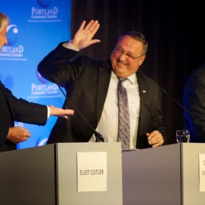 Governor Paul LePage slaps Eliot Cutler's hand at a debate in Portland on Wednesday morning. - Troy R. Bennett | BDN