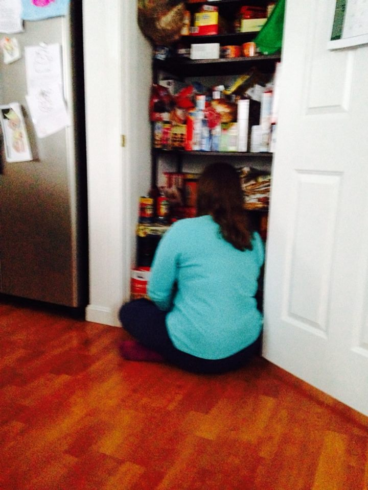 Organizing the pantry.  I put cereal on the pasta shelf, messed her whole day up.