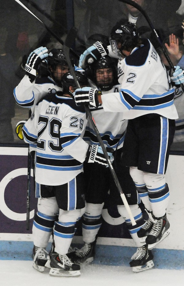 Maine celebrates the first goal of the night