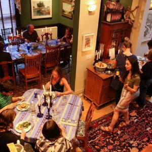 Guests take their seats for a salmon dinner at an in-home theater production in a West End home in Portland in May. (The Forecaster photo by Ben McCanna)
