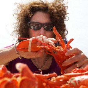 Catherine Davidson chows down on as many lobsters as she can in ten minutes during a crustacean eating contest in Portland Saturday June 30, 2012. The fourth annual Portland Lobster Festival was organized by the Falmouth Rotary and took place on the Maine State Pier. (BDN photo by Troy R. Bennett)