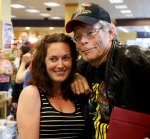 Stephen King poses for a photo with Tara McConnell of Westbrook Saturday at Books a Million in South Portland. King was on hand for a book signing and reading by his son, Joe Hill. (BDN photo by Troy R. Bennett)