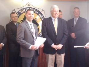 U.S. Rep. Mike Michaud, Democratic candidate for governor, received the endorsement of the Maine State Troopers Association from the union's interim president, Aaron Turcotte, on Monday in Augusta. BDN photo by Christopher Cousins