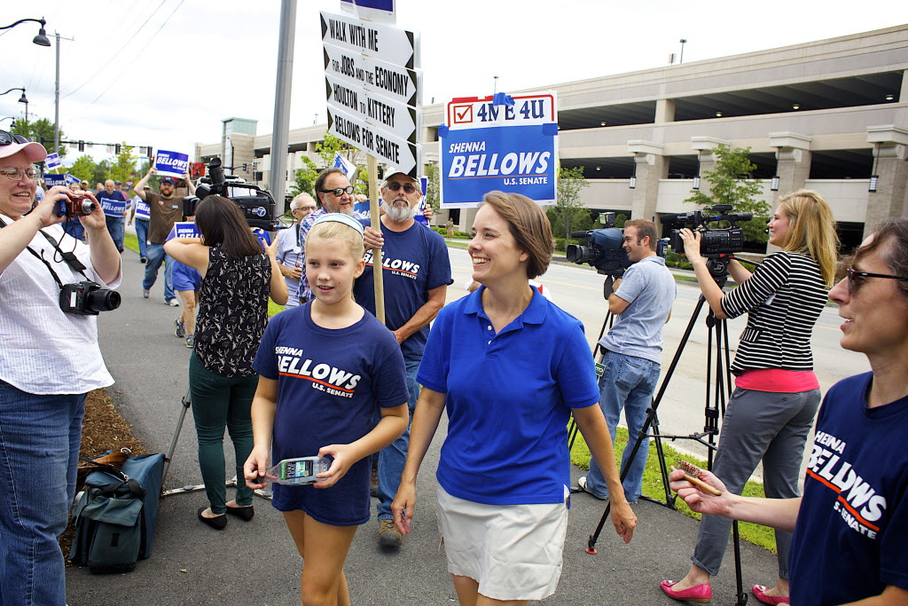 Shenna Bellows, Democratic Party candidate for the U.S. Senate, walks with supporters in Bangor during her 350-mile walk through Maine.  BDN file photo by Brian Feulner.
