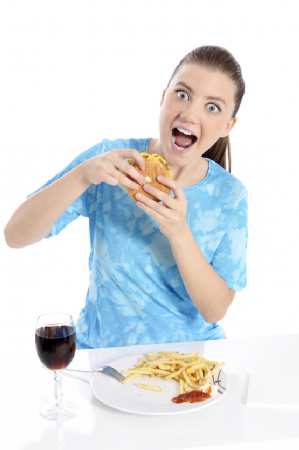 """Don't judge me! I'm possessed and not responsible for my behavior until my PMS passes!"" Photo Woman eating fast food - © Softdreams 