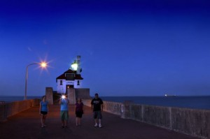 "Tourists walk along the Harbor jetty late evening in Duluth, Minnesota, Outdoor magazine's ""Best Town Ever."" (Tom Wallace/Minneapolis Star Tribune/MCT)"