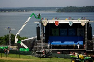 "Workmen erect one of two stages in Portland's Eastern Promenade park Friday, Aug. 3, 2012 in preparation for the Mumford and Sons ""Gentlemen of the Road"" tour stop. (BDN photo by Troy R. Bennett)"