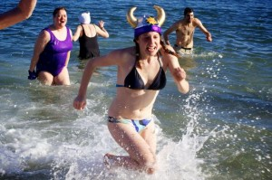 Outdoor magazine notes that Portlanders make the best of their long winters by nordic skiing and pond hockey. But they forgot to mention winter swimming, as seen here during one of Portland's annual Polar Dips. (BDN file photo by Troy R. Bennett)