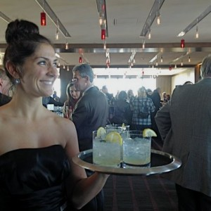 A waitress serves drinks at the Westin Portland Harborview hotel's Top of the East lounge. (BDN photo by Kathleen Pierce)