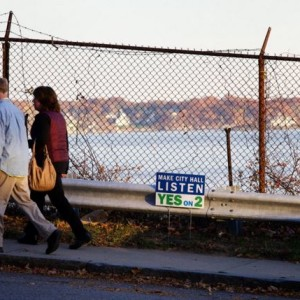 Pedestrians pass by a view of Portland Harbor on Fore Street in Portland in November, a day before voters decided the fate of a 'Scenic Views' ordinance. (BDN photo by Troy R. Bennett)