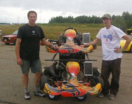 Mark Daniele on left with his son Jake both of Pownal will set some of the fastest times of the weekend in their Integra 125 Shifter karts. Jake set fastest time in 2012 and 2013