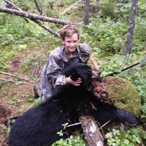 Kaleb Goodine, 12, of Levant shows off the bear he shot last year. Goodine completed a grand slam, shooting a bear, a moose, a deer and two turkeys during the season. (Photo courtesy of Walter Goodine)