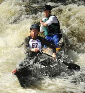 Jeff Owen (foreground) and Steve Woodard negotiate the drop at the Emerson Mill Road bridge during the 36th annual Souadabscook Stream Canoe Race back in 2011. (BDN PHOTO BY GABOR DEGRE)