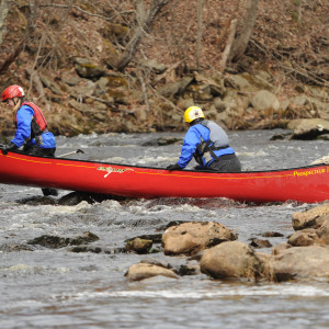 A pair of paddlers competing in the St. George river race in Searsmont get stranded on rocks due to low water on Saturday, March 31, 2012. The race has been postponed twice already this year because of ice on the river. ( BDN file photo)