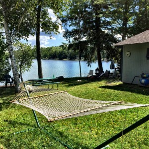Summertime at camp. Hammock. Water. What more do you need? (BDN photo by John Holyoke)