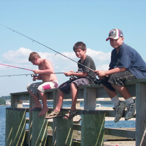 FINE DAY FOR FISHING   Tuesday was a fine day for fishing at the Searsport public landing and three boys from Belfast made the most of it. Friends, Shawn Secotte (from left) Tyler Tran and Baxter Smith landed a bunch of mackerel and a couple of small codfish. (BANGOR DAILY NEWS PHOTO BY WALTER GRIFFIN)