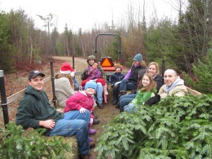 Courtesy of Great Pond Mountain Wildlands Visitors to the Wildlands enjoy a hayride with their hand-picked Christmas tree in December 2012.