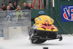 BDN photo by Aislinn Sarnacki Mike Moulton of China, Maine, accelerates on the Medway ice dragway on Jan. 18, 2014 during the Northeast Winter Nationals Snowmobile Ice Drag Races.