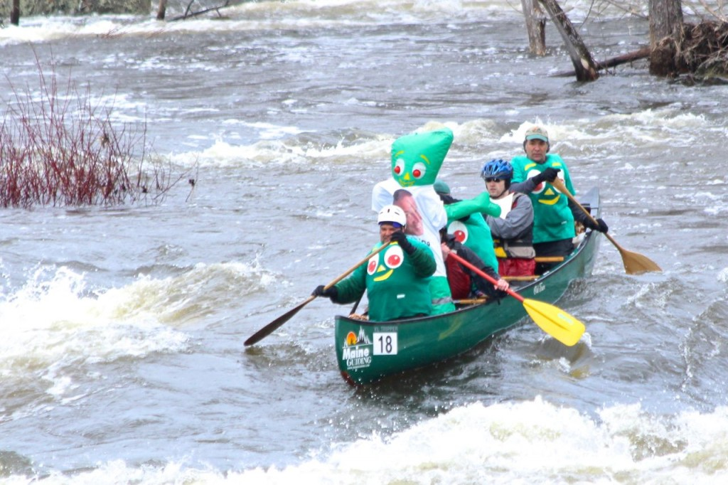 Gumby! First he saved a few racers who'd upended their boat above the falls, then he made it over the rapids!