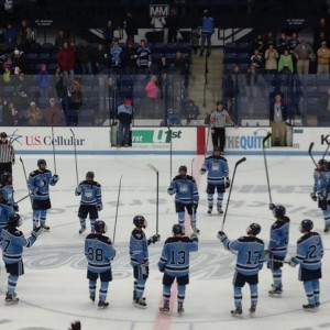 The University of Maine hockey team celebrates a victory at Alfond Arena in November.