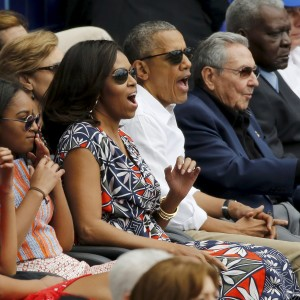 President Obama and his family sit with Cuban President Raul Castro at an exhibition baseball game between the Cuban national team and Major League Baseball's Tampa Bay Rays at Estadio Latinoamericano in Havana on Tuesday.  Jonathan Ernst | Reuters