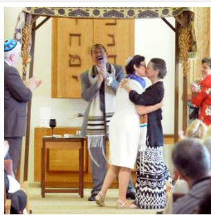 Photo: Gabor Degre | BDN Rabbi Darah Lerner (left) and her spouse Kelly Quagliotti kiss at the end of their wedding ceremony at Congregation Beth El in Bangor, July 2013