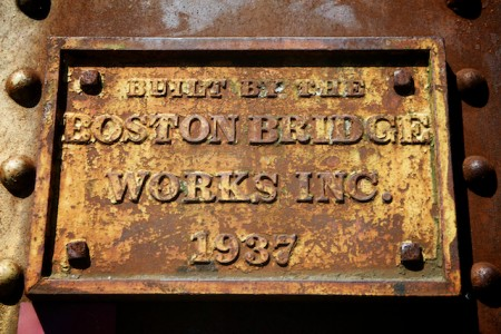 The plate on the bridge connecting Standish and Limington at Steep Falls. It was built the year after the great flood of 1936. (Bangor Daily News photo by Troy R. Bennett)