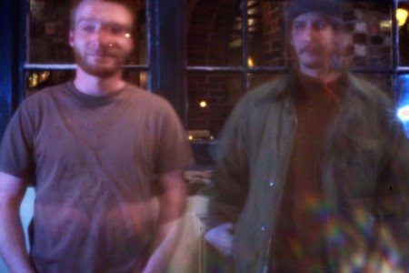 A photo of two guys on Fore Street in Portland taken with a pinhole on my digital camera instead of a lens. I used a tripod and left the shutter open for 30 seconds.