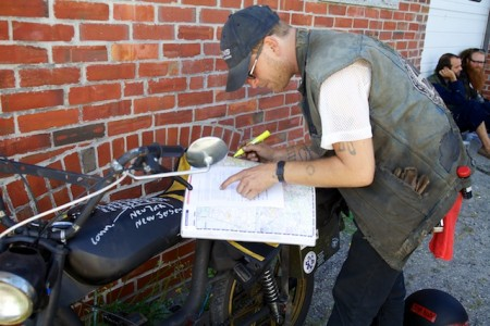 Shawn Lukitsch maps out his route before the start of the Pinball Run in Portland Friday. Participants in the rally plan to ride they vintage mopeds all the way to Key West in nine days. Troy R. Bennett | BDN