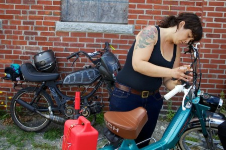 Sarah Lyon of York, Penn. gets her vintage Puch moped ready before the start of the Pinball Run in Portland Friday. The rally will take more than a dozen vintage moped riders to Key West in nine days. Troy R. Bennett | BDN