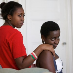06/20/15 -- Burundian refugees Audrey Iradukunda, 20, (left) and Chanelle Irakoze, 19, talk with friends in Portland on Friday. Both hope to be doctors. Iradukunda just graduated from Portland High School and Irakoze is working three summer jobs after finishing her first year of college. Troy R. Bennett | BDN