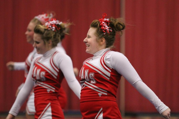 Cony High School's Savannah Gilbert performs with her team during Regional Cheerleading Competition at the Augusta Civic Center on Saturday night.