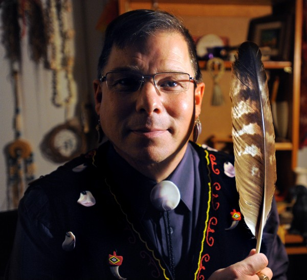 David Slagger of Kenduskeag is the Maliseet Indian representative in the Maine House. Pictured in his home, he is holding the same golden eagle feather he held when he was sworn in by Gov. Paul LePage on Jan. 4, 2012. Slagger became the first member of the Houlton Band of Maliseets to serve in the Legislature.