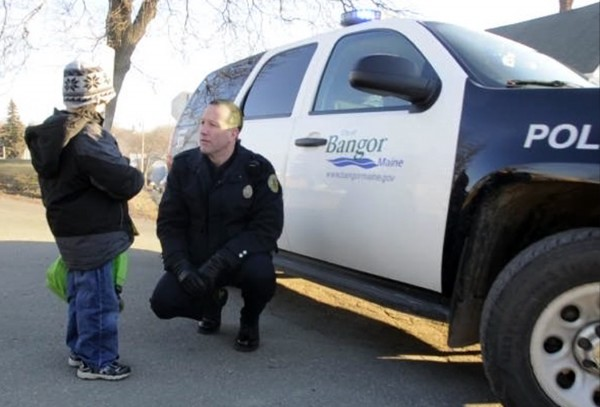 Five-year-old Luke Saucier, a kindergartner at Vine Street School in Bangor, talks with Bangor Police Community Relations Officer Jason McAmbley who chauffered him to school in a patrol vehicle on Monday, Jan. 9, 2012.