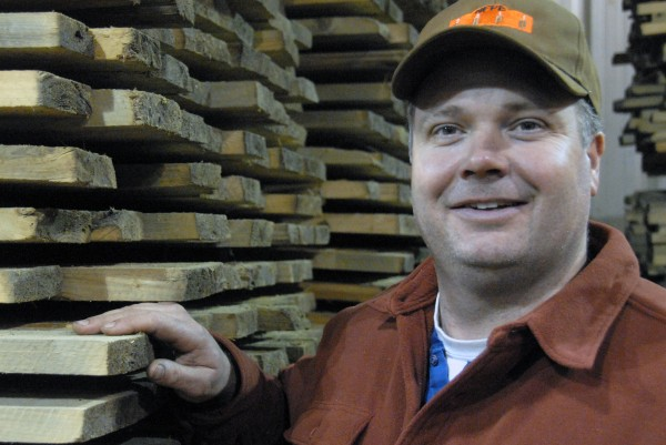 Steve Sanders, co-owner of West Branch Heritage Timber LLC., stands by some finished flooring at his mill off Golden Road on Thursday, Jan. 5, 2011.