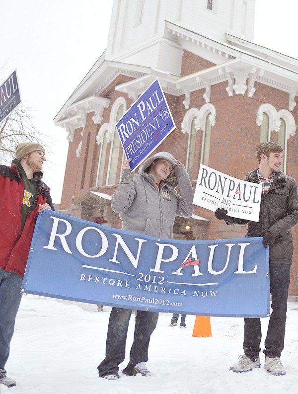 Supporters of Republican candidate Ron Paul braved the weather to stump for him outside the Brick Church on Union Street in Bangor on Friday Jan. 27, 2012.