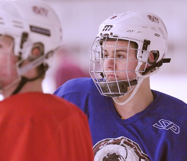 Parker Sanderson, who recently transfered from Houlton High School to Bangor High, practices with the Bangor ice hockey team Wednesday, Jan. 18, 2012.