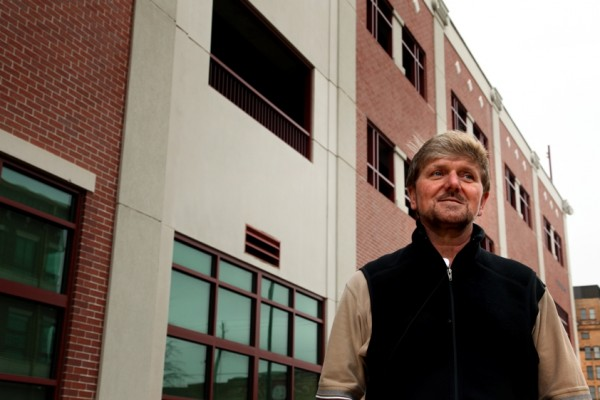 Ed Barton, whose family owned Tuscaloosa Furniture in downtown Tuscaloosa, Ala., stands in front of the four-story parking garage that the city built after the furniture business was forced out in an urban renewal project. The project was funded by $80 million of federal earmarks championed by Sen. Richard Shelby, R-Ala.