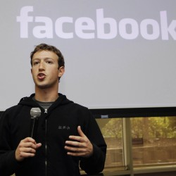 FILE - In this May, 26, 2010 file photo, Facebook CEO Mark Zuckerberg talks about the social network site's new privacy settings in Palo Alto, Calif. Zuckerberg turns up at business conventions in a hoodie. (AP Photo/Marcio Jose Sanchez, File)