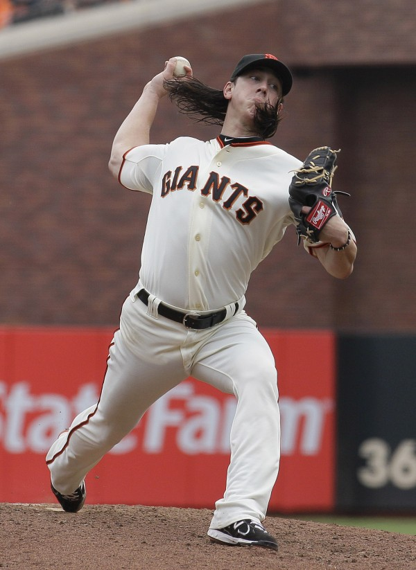 In this Sept. 14, 2011, file photo, San Francisco Giants pitcher Tim Lincecum delivers against the San Diego Padres in a baseball game in San Francisco. The two-time NL Cy Young Award winner and the Giants have reached a verbal agreement on a two-year contract worth $40.5 million.