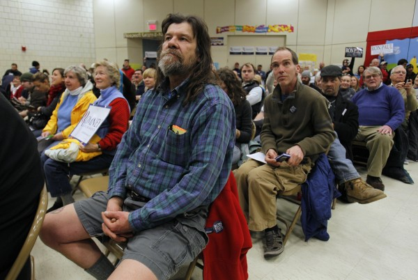 Zoo Cain (foreground) attends a crowded caucus in Portland on Saturday, Feb. 11, 2012.