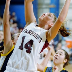 Nokomis High's Marissa Shaw (14) looks for two points during first half action of the girls class B quarterfinals at the Bangor Auditorium.
