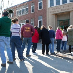 Parents wait in line to pick up their children at Walpole Elementary School where a 14-year-old male student shot himself in front of many classmates in the school's cafeteria in Walpole, N.H. on Friday, Feb. 10, 2012.