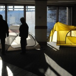 People check tents displayed by Epic Sports at the Bangor Auditorium and Civic Center during the Camping and RV Show in Bangor on Friday, Feb. 3, 2012.