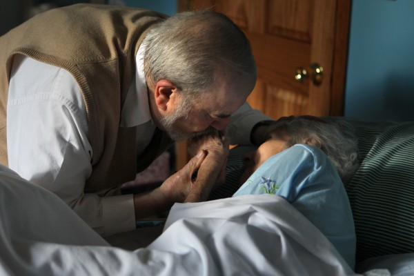 Dr. Herbert Lerner kisses his wife Dr. Ruth Lerner's hand, while she rests in her bed at his son's Berwyn, Illinois home, February 8, 2012.