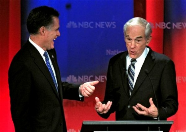 In this Jan. 23, 2012 file photo, Republican presidential candidates, Rep. Ron Paul, R-Texas, right, and former Massachusetts Gov. Mitt Romney share a laugh during a break in a Republican presidential debate at the University of South Florida in Tampa, Fla., last month.