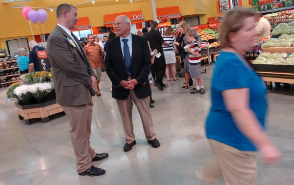 Dale McMindes (left), manager of the Walmart Supercenter in Bangor, speaks with Rodney McKay, director of Bangor's Department of Community and Economic Development, during opening festivities for the new store on Stillwater Avenue in July 2009.