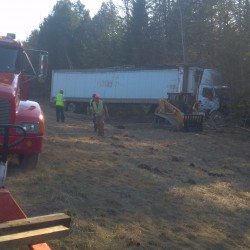 No one was injured Wednesday, March 21, 2012, when a tractor-trailer truck carrying 41,000 pounds of butter lost control on Interstate 295 near Bowdoinham and crashed into the woods.