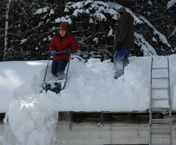 Late season snowfalls in northern Maine have been a major boost in the area's snow-related winter economy. At the same time, it's meant some extra work keeping rooftops and driveways clear and safe.