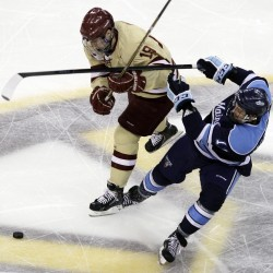 Boston College's Chris Kreider (19) and Maine's Theo Andersson, right, fight for control of the puck in the first period of the Hockey East final in Boston, Saturday, March 17, 2012.